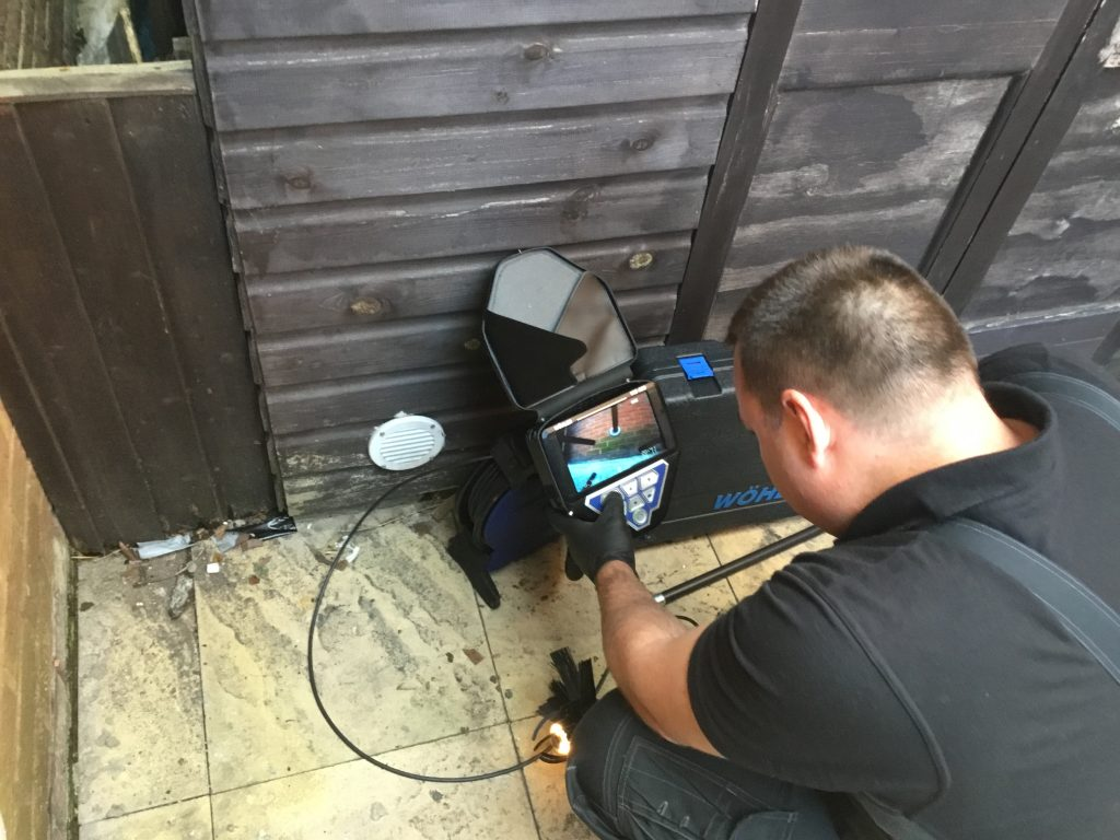 Daniel Hodgson master chimney sweep performing a chimney camera survey.