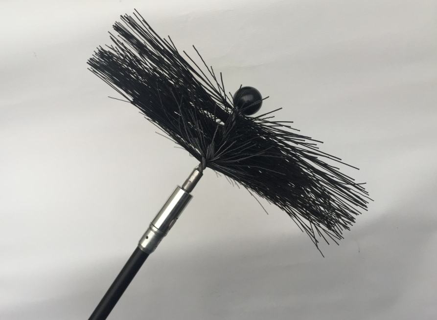 A rotary Mole brush used for chimney sweep essex